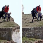Heart-stopping moment young girl held back as she peers over 400ft cliff edge at beauty spot