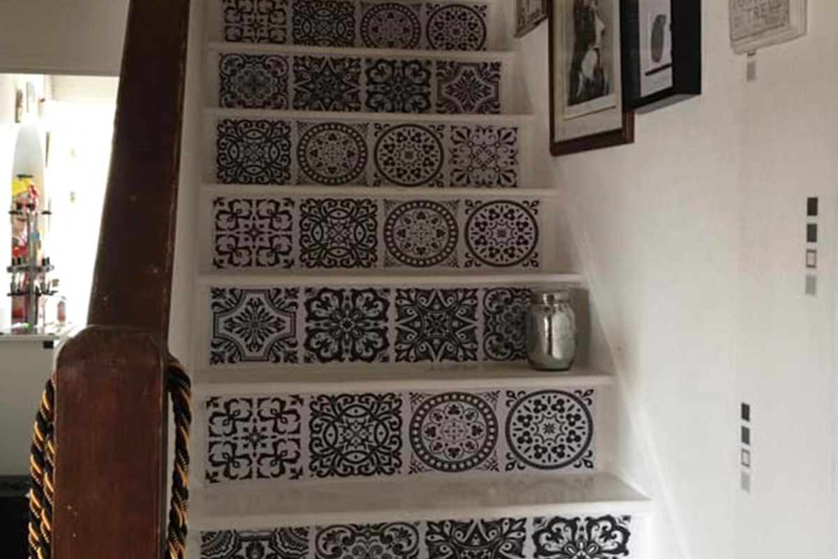 Woman uses an eBay stickers to brighten up her stairs and people think it looks just like a Spanish holiday home