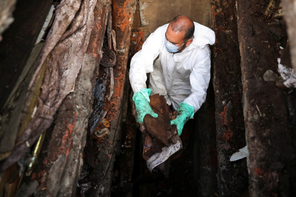 Overflowing Brazil cemetery digs up 1,000 skeletons to make room for more Covid victims as deaths spiral out of control