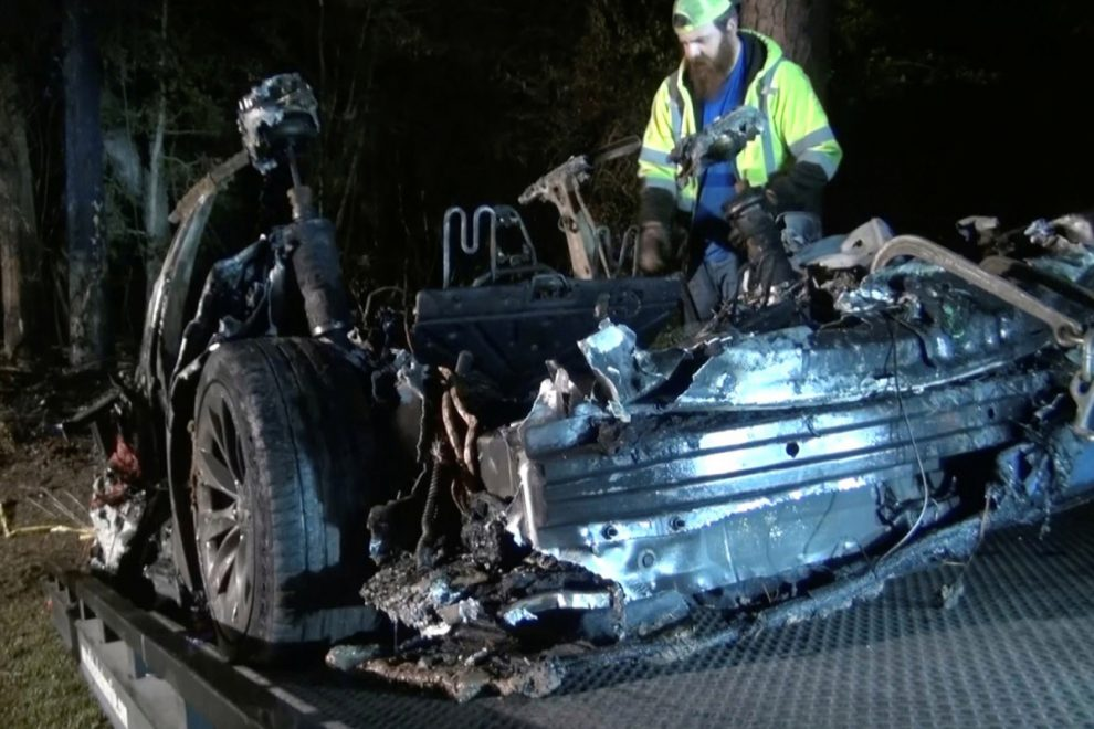 Two men who died in Tesla crash after 'no one was driving' are pictured as loved ones say they're going through 'hell'