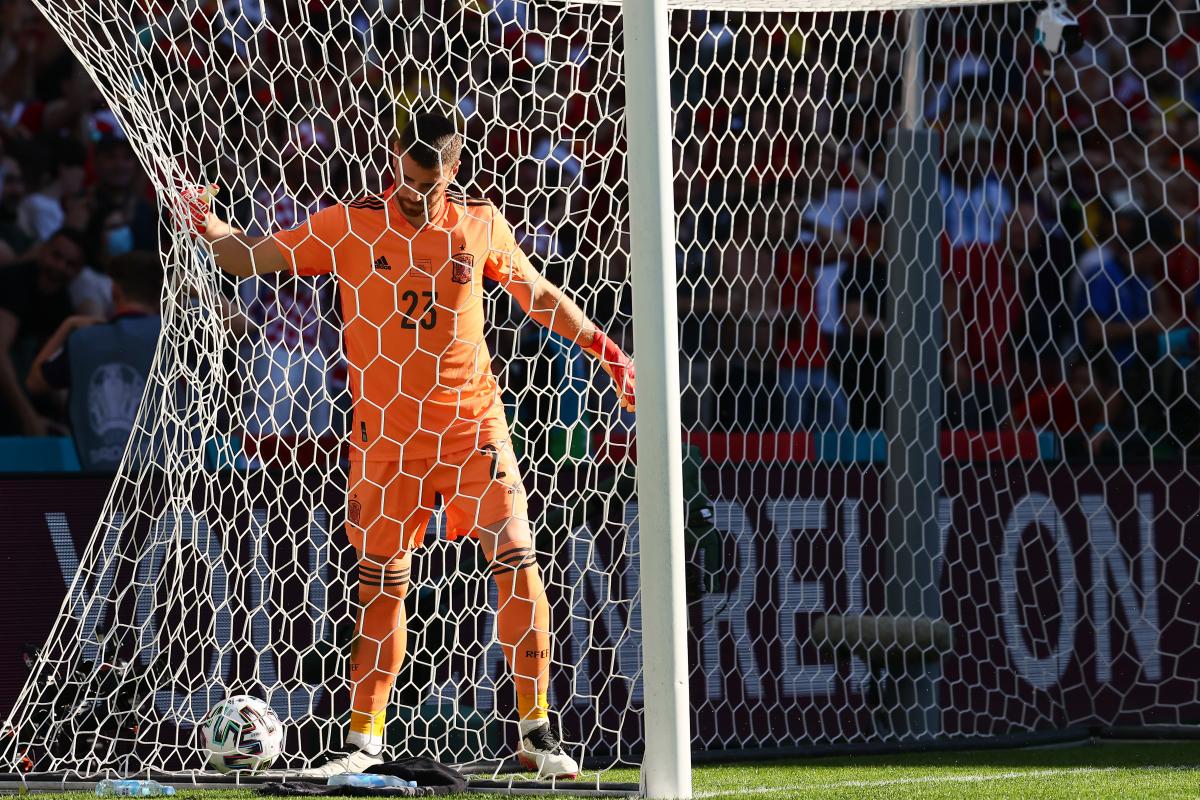 Watch Spain star Unai Simon score horror own goal as keeper lets halfway line back-pass creep under foot against Croatia